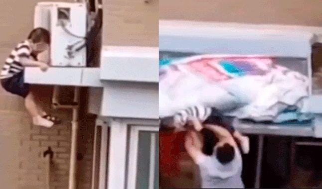 Heroico hombre atrapa en el aire a niño que cae desde un quinto piso [Video]